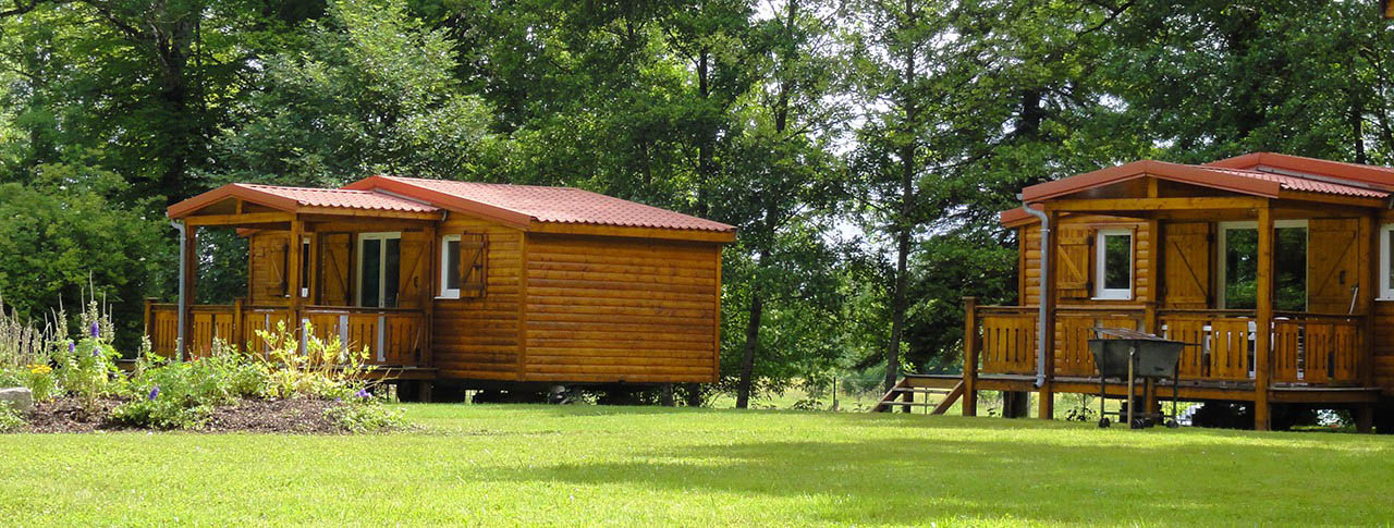 Location chalet camping france flower campings location de chalets en bois en camping for Chalet de jardin bretagne